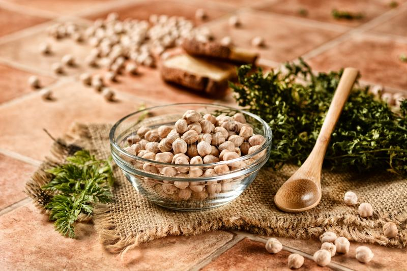 Raw chickpeas in the glass bowl royalty free stock photography