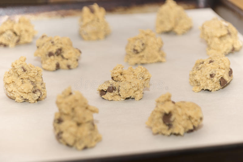 Raw chocolate chip cookie dough balls ready to be baked in the o stock image