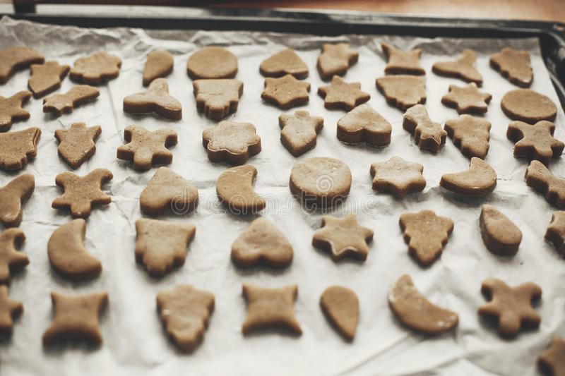 Raw christmas gingerbread cookies on baking tray. Trees, stars royalty free stock photo