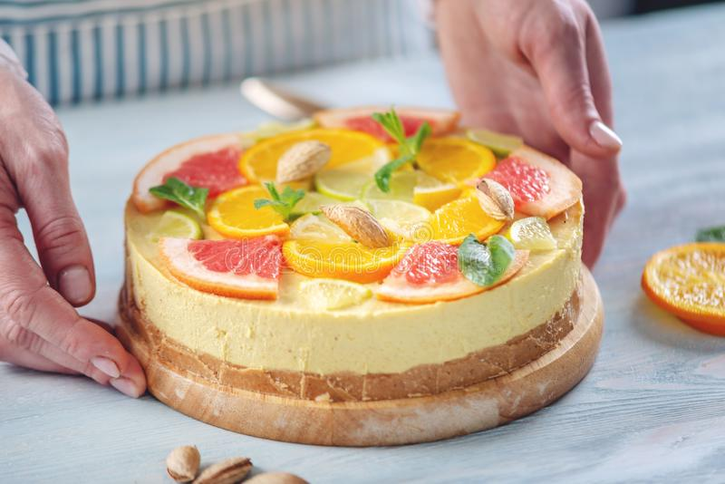 Raw citrus cake with grapefruit, orange, lime and lemon with nuts and mint. Healthy fresh summer dessert royalty free stock photo