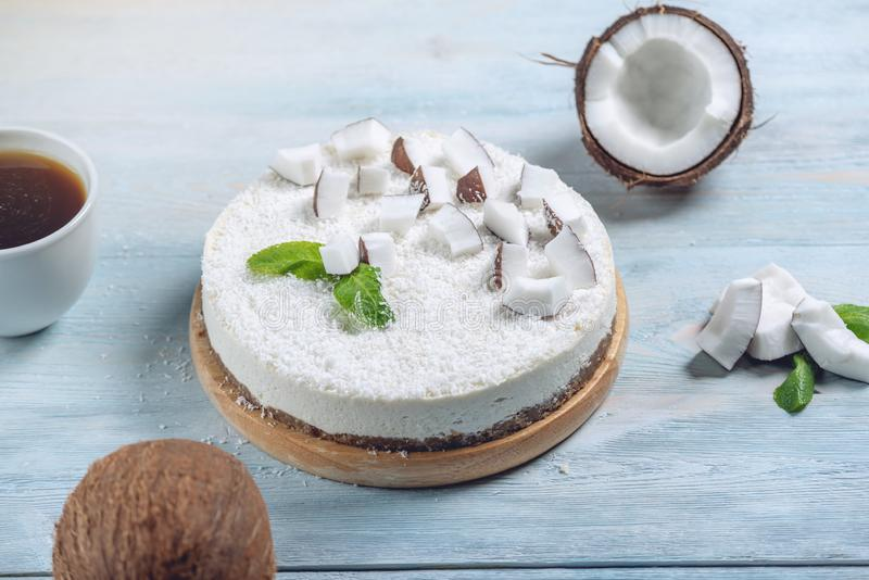 Raw coconut cake decorated with white pulp and mint. Healthy summer vegan dessert. Gluten free and sugar free food royalty free stock images