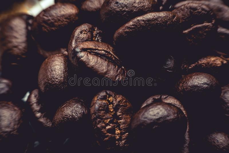 The raw coffee beans are preparing to grind into delicious coffee.This image is soft focus stock photos