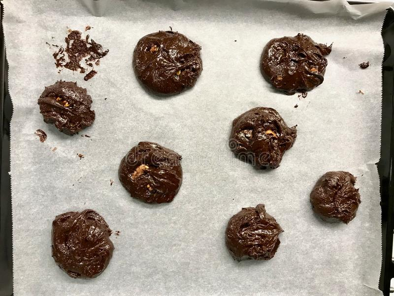Raw Cookies on Oven Tray Ready to Cook / Chocolate Brownie with Walnut Cookie. Organic Dessert royalty free stock photos