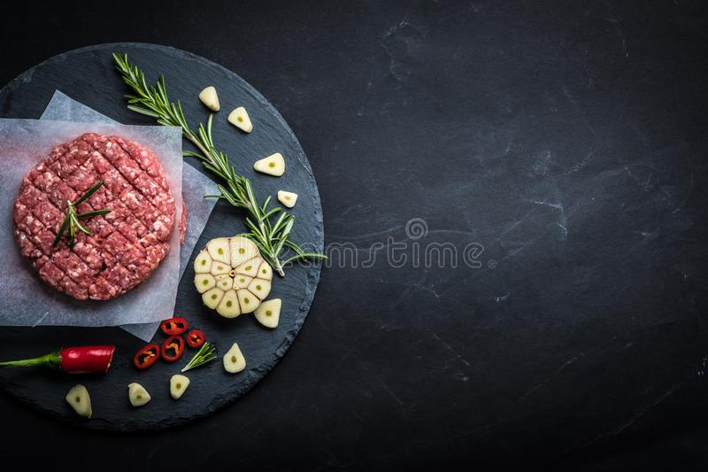 Raw cutlet for homemade burger stock photos