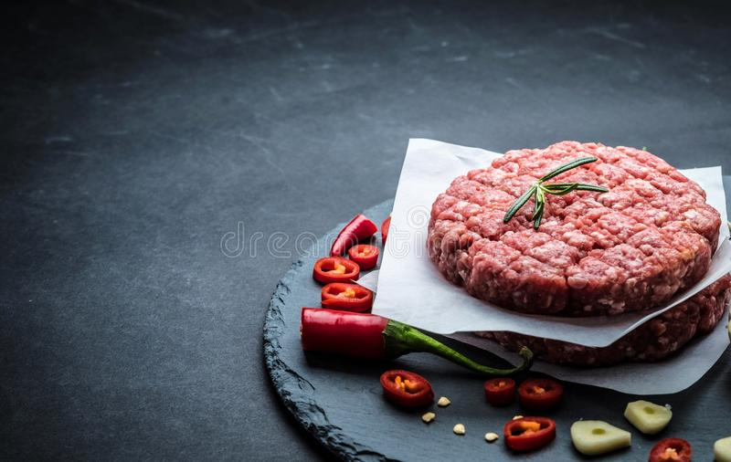 Raw cutlet for homemade burger stock images