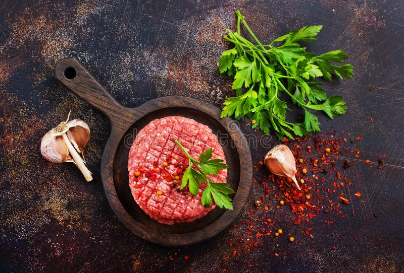 Raw cutlets for burger stock photos
