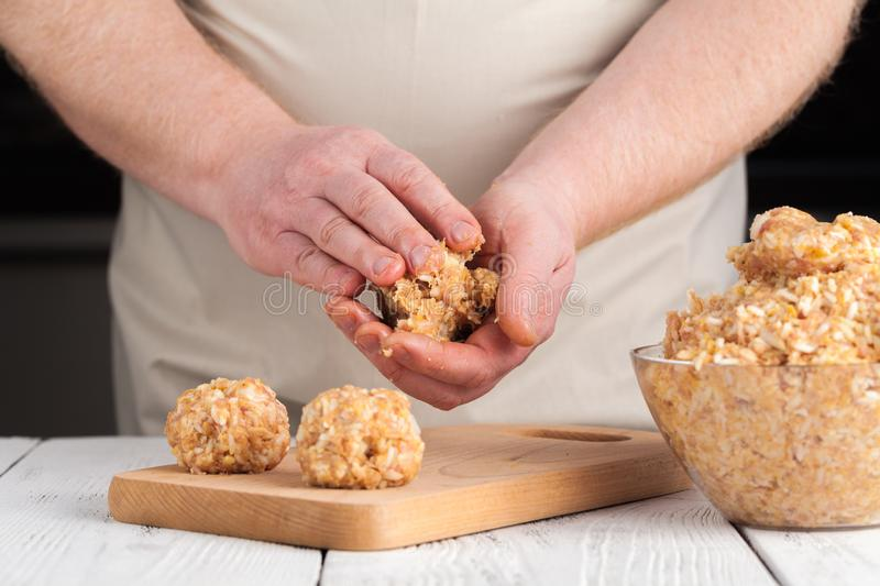Raw diet chicken meatball cooking process stock images