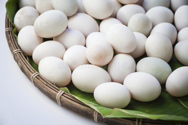 Raw dirty duck eggs in bamboo basket stock image