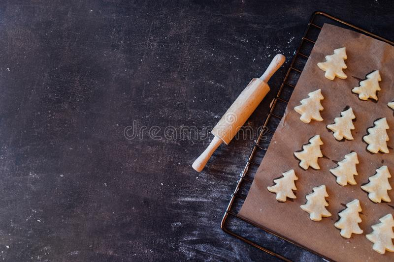 Raw dough cookies in Christmas tree shape ready to bake royalty free stock image