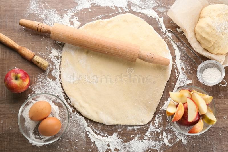Raw dough and ingredients for apple pie royalty free stock image