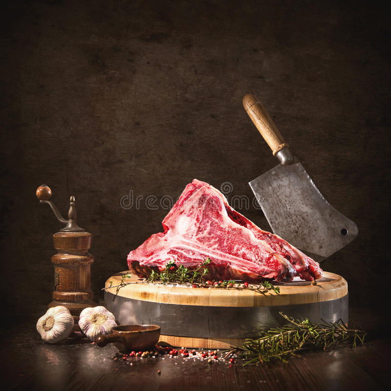 Raw dry aged t-bone steaks for grill stock images