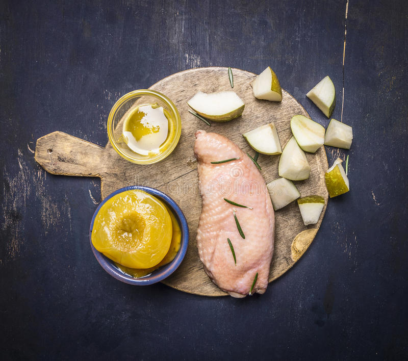 Raw duck breast with pears, peaches and honey on a cutting board wooden rustic background top view close up royalty free stock photos