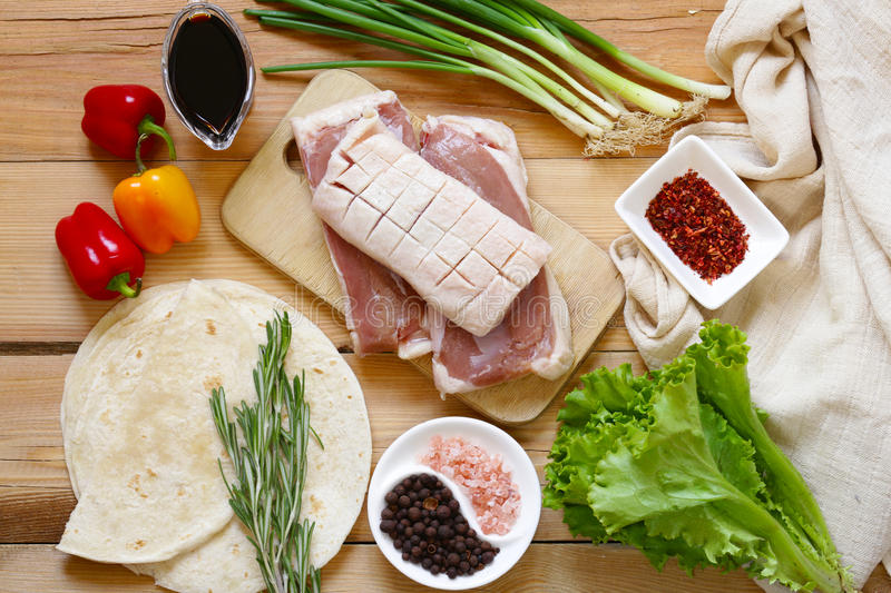 Raw duck fillet, spices and sauces royalty free stock photo