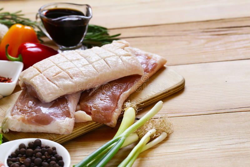 Raw duck fillet, spices and sauces royalty free stock photography