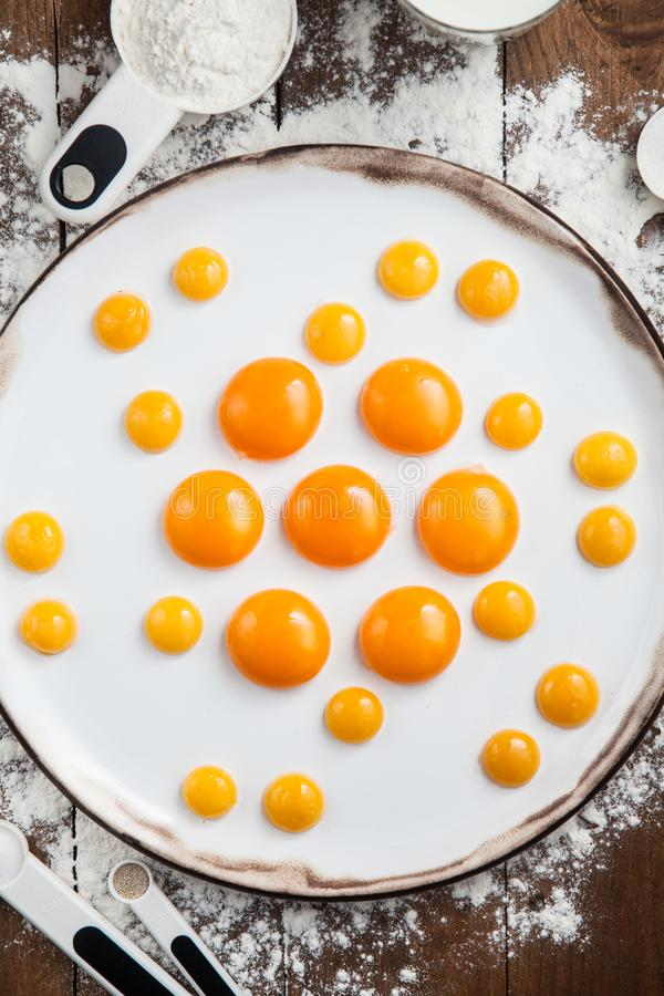 Raw egg yolks on white plate royalty free stock photos