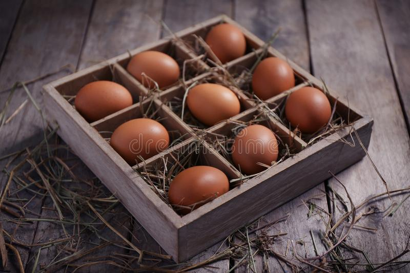 Raw eggs in box. On wooden background royalty free stock image