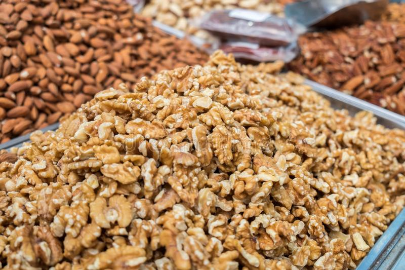 Raw English walnut nuts for sale at local city market royalty free stock photo