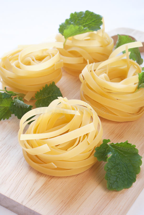 Raw fettuccine on the cutting board royalty free stock image
