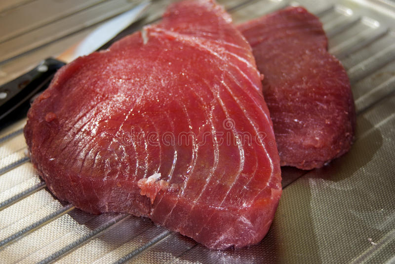 Raw fillet of tuna. Fresh and healthy fish: raw fillet of tuna royalty free stock photos