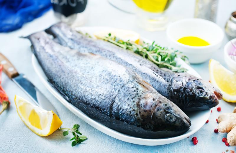 Raw fish. On board and on a table royalty free stock photos