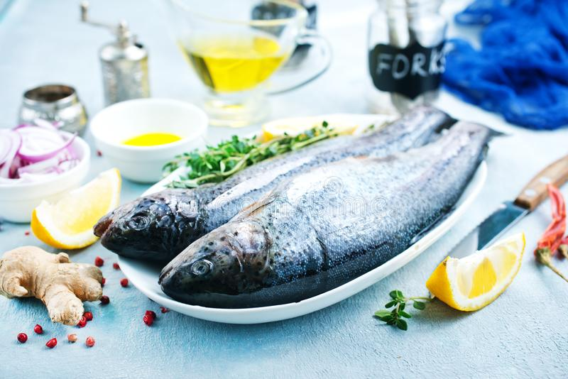 Raw fish. On board and on a table royalty free stock photography