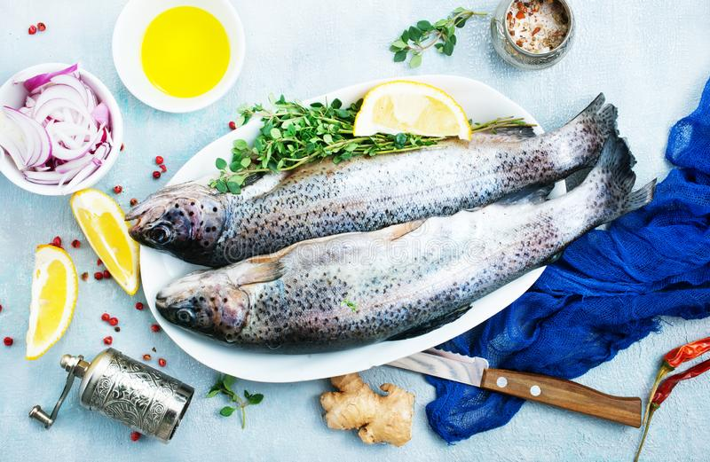 Raw fish. On board and on a table royalty free stock images