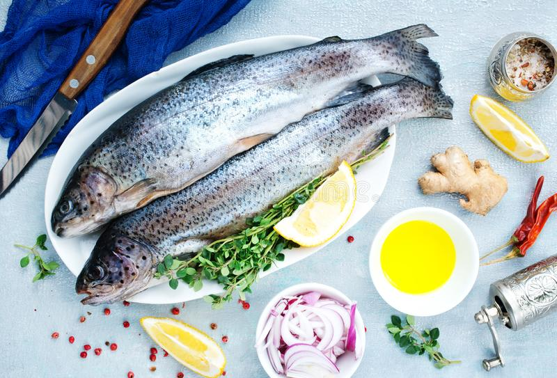 Raw fish. On board and on a table royalty free stock photo