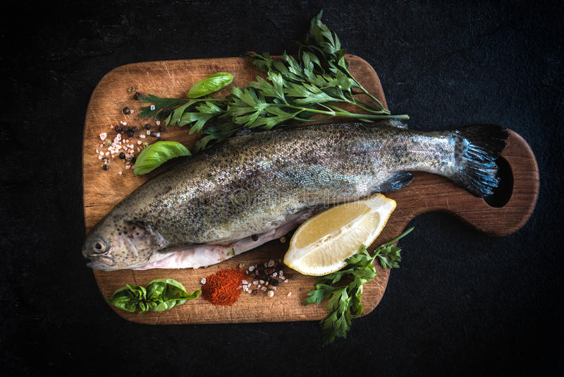 Raw fish on the board royalty free stock photography