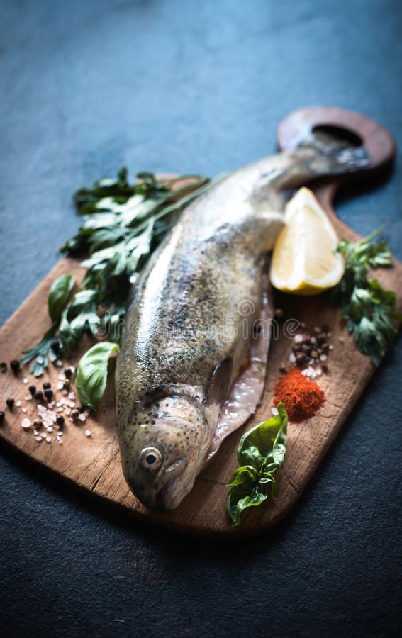 Raw fish on the board royalty free stock image