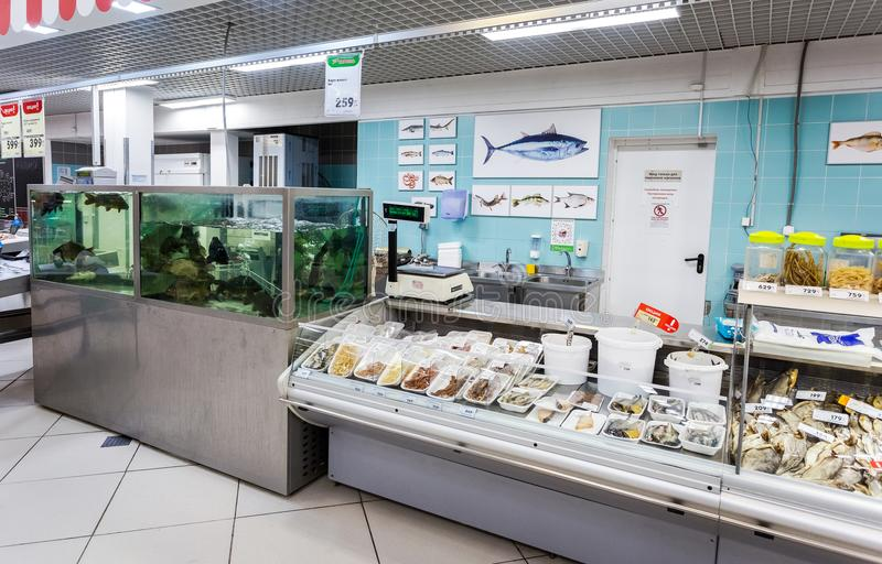 Raw fish ready for sale in the hypermarket Karusel. Samara, Russia - September 3, 2017: Raw fish ready for sale in the hypermarket Karusel. One of largest stock photos