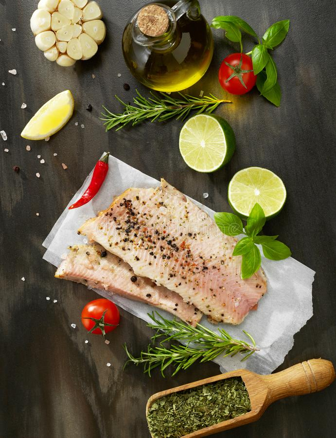 Raw fish and spices royalty free stock image