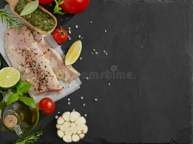 Raw fish and spices royalty free stock photo