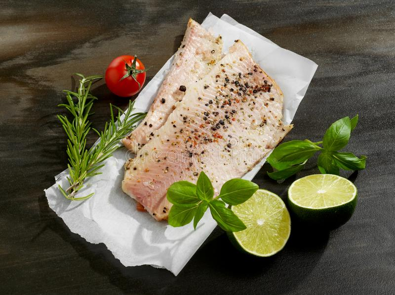 Raw fish and spices stock photo
