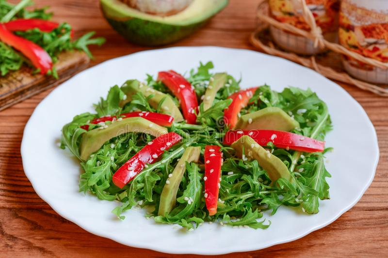 Avocado arugula and red pepper salad on a white plate homemade download avocado arugula and red pepper salad on a white plate homemade arugula and forumfinder Gallery