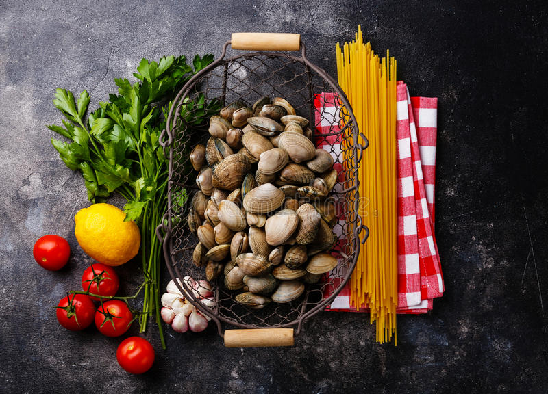 Raw food Ingredients for cooking Spaghetti alle vongole royalty free stock photos