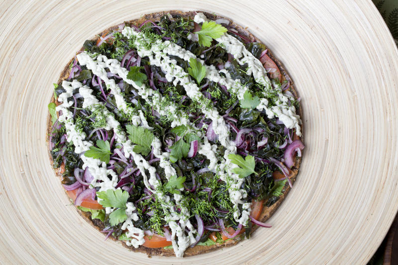 Raw food pizza with vegetables. On dried Shortcakes stock photography
