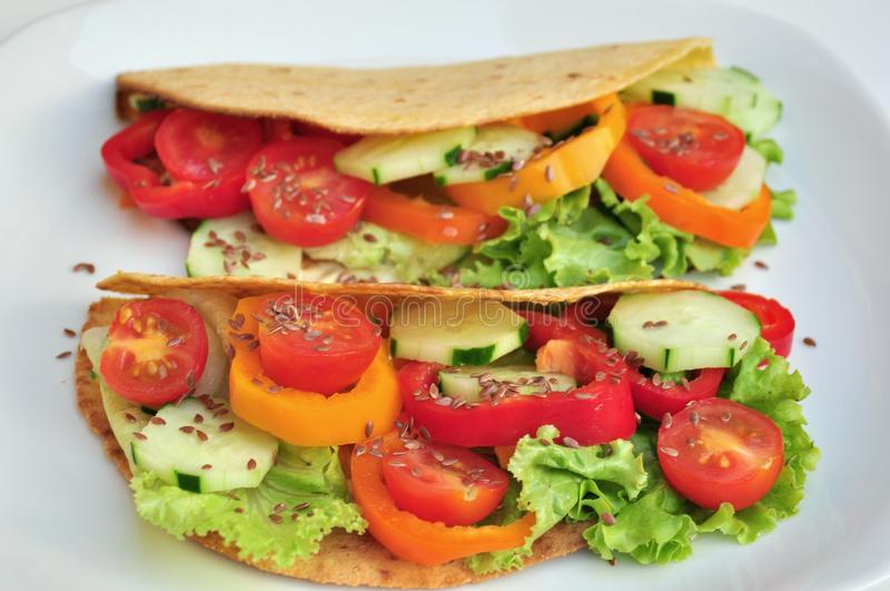 Raw food rolls with fresh vegetables stock image
