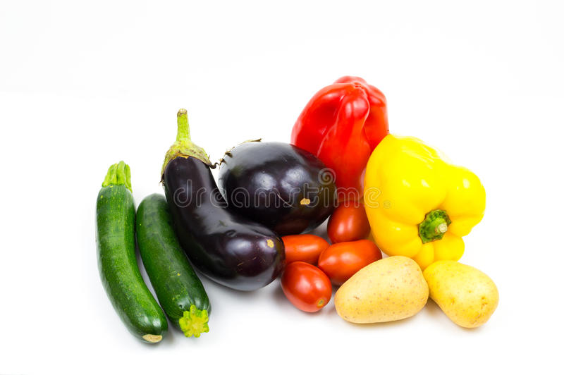 Raw food vegetables isolated on white background with copyspace, pepper, eggplant, tomato, potato and zucchini close up stock image
