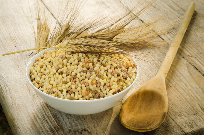 Raw fregola stock photos