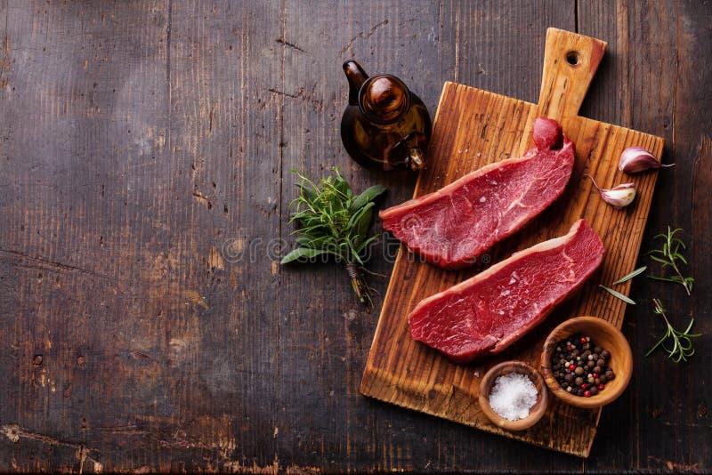 Raw fresh meat Striploin steak and seasoning stock images