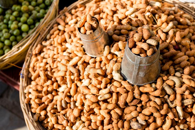 Raw fresh organic peanut. In shell groundnut. Healthy food on the farmer market.  royalty free stock images