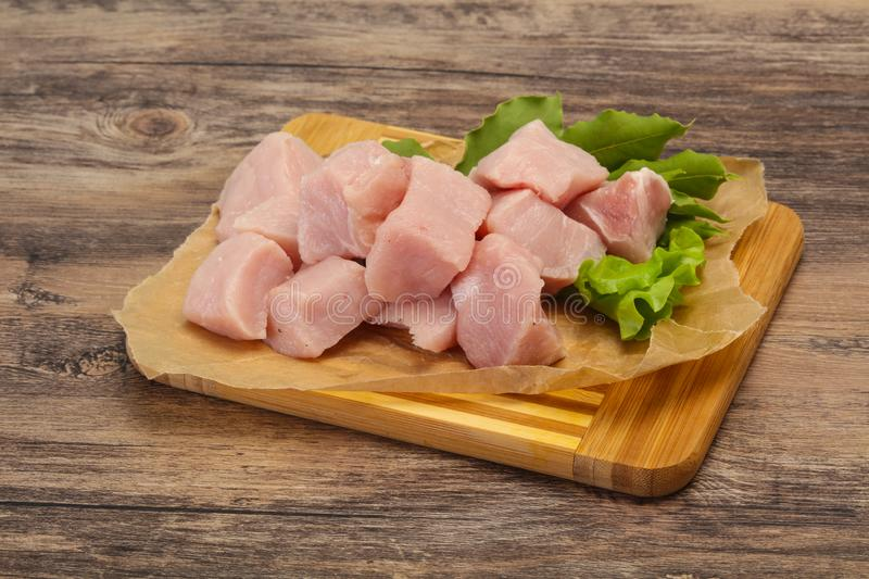 Raw fresh pork meat cube. Ready for cooking royalty free stock image