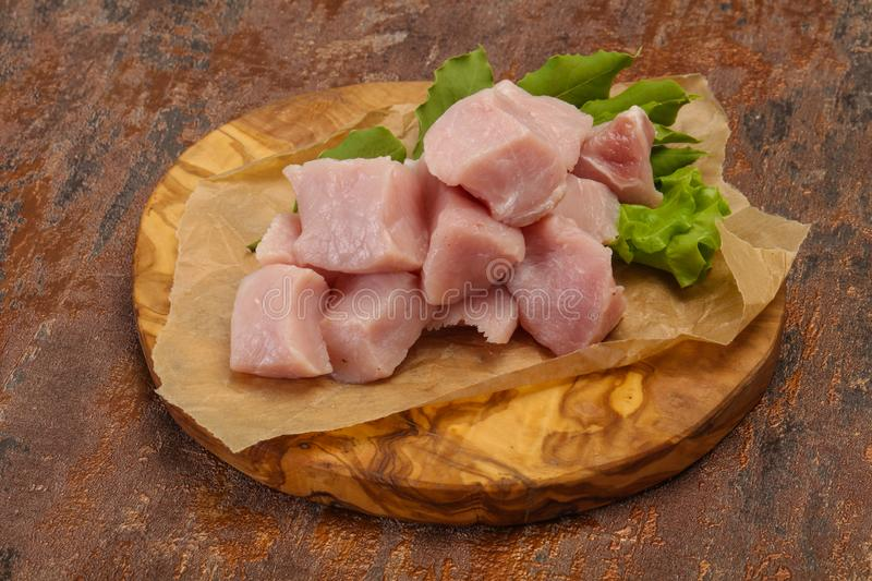 Raw fresh pork meat cube. Ready for cooking royalty free stock photo