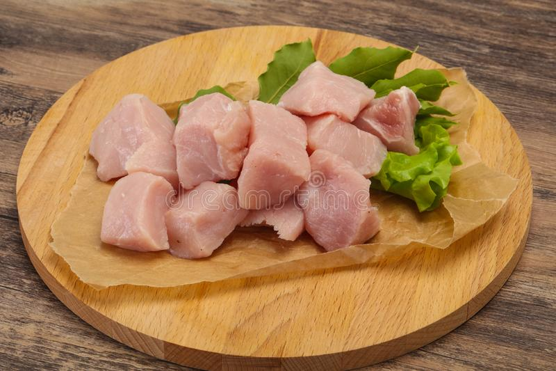 Raw fresh pork meat cube. Ready for cooking stock photography