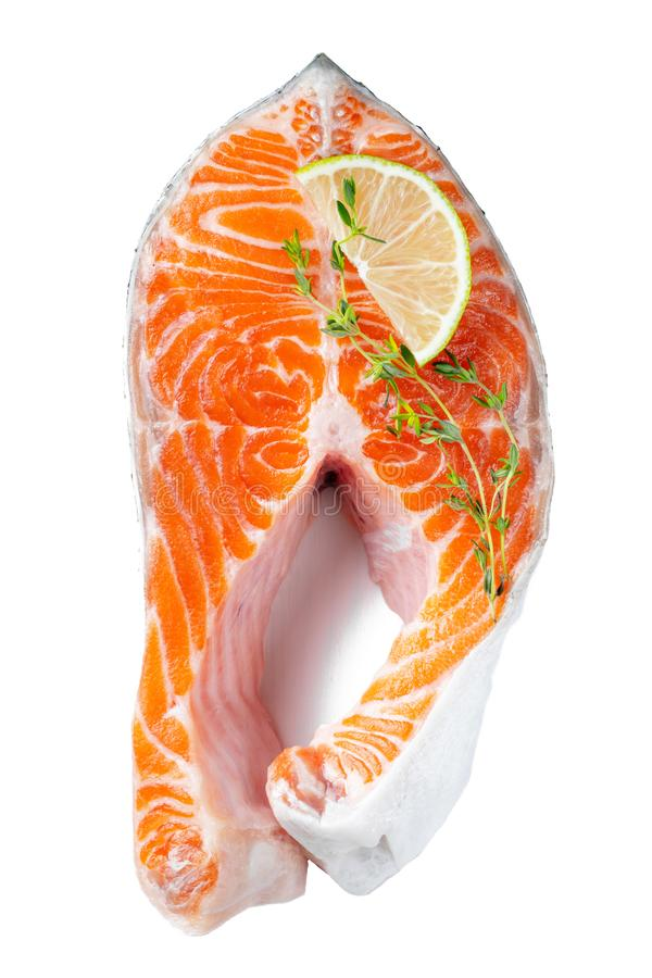 Raw fresh salmon or trout steak, rich in omega-3 oil, with lime, thyme and olive oil on a white background. Healthy and dietary stock photo