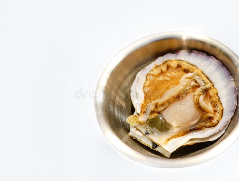 Raw fresh scallop on white background stock photo