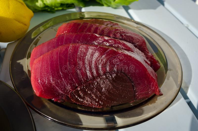 Raw fresh tuna steaks on the plate royalty free stock photos