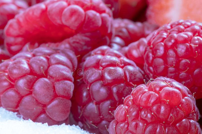 Raw. Fruits. Raspberry. Macro. Sugar. Red royalty free stock images