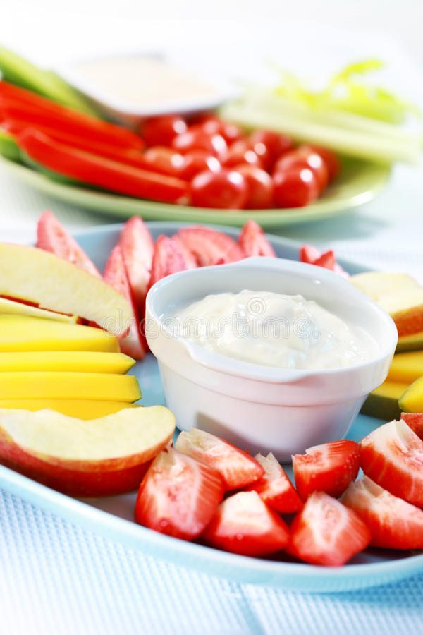 Raw fruits and vegetables with dip stock photos