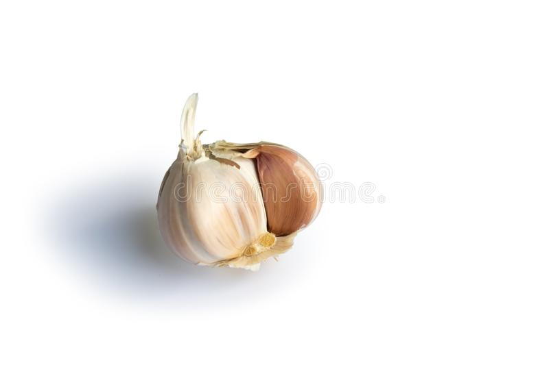 Raw garlic head isolated on white background close-up. Organic, healthy, natural, object, plant, vegetable, leaf, life, part, green, bulb, food, fresh, ripe stock images